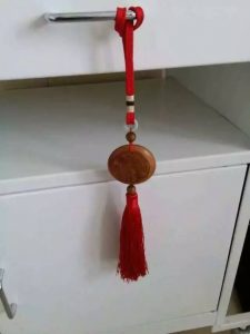 Chinese good luck charm hanging from hospital cabinet