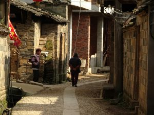 View down sunlit street of Chengcun village